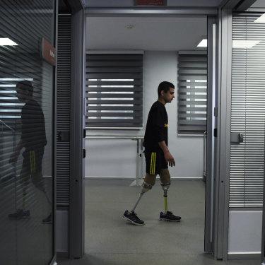 'I am ashamed': Abdalrahman tries out his new legs.