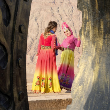 Women in Uighur costumes at the Flaming Mountains in Turpan, Xinjiang, last month.