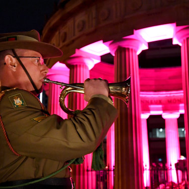 An army bugler is seen playing the last post during the Anzac Day dawn service at  the Shrine of Remembrance in Anzac Square in Brisbane, Thursday, April 25, 2019.