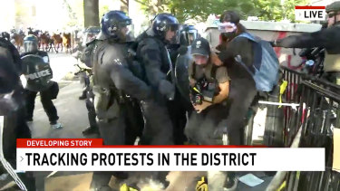 A screen-capture taken from video shows Network Seven cameraman Tim Myers and reporter Amelia Brace as they were assaulted by police officers while covering protests outside the White House.