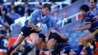 Tim Gavin takes a carry for the Waratahs in a match in 1996.