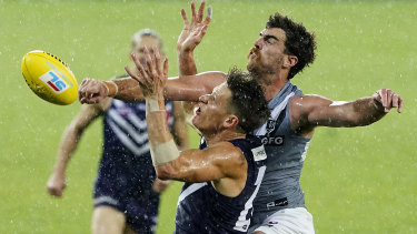 Knockout blow: Dockers' ruckman Scott Lycett spoils a marking attempt by Port's Matt Taberner.