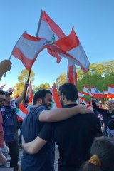 Members of the Lebanese-Australian community in Melbourne demonstrate in solidarity with Lebanon's anti-government protesters in Carlton on Wednesday.