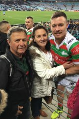 Family affair: Damien Cook with parents Graham and Anne.