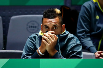 Nick Kyrgios watches on, unable to play because of a collarbone problem.