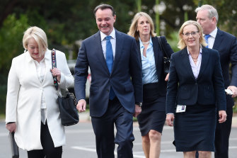 Michael O'Brien arrives at state parliament on Tuesday morning flanked by allies.