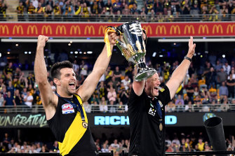 Skipper Trent Cotchin and Damien Hardwick lift the 2020 premiership cup.