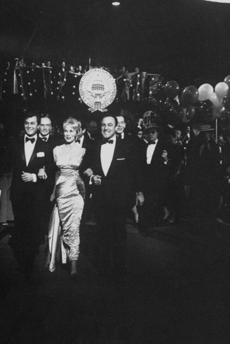 Actors Tony Curtis, Janet Leigh and Gene Kelly at John F Kennedy's inaugural ball in 1961.