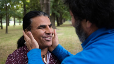 """Afghan refugee from Australia , Abdul Aziz, 48, is hugged by a complete stranger saying, """"You are a hero , you saved our lives."""""""