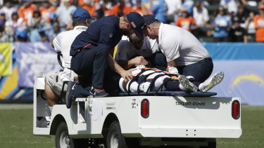 Scary moment: Denver Broncos cornerback DeVante Bausby is taken off the field after being hurt during the first half of the game against the Los Angeles Chargers.