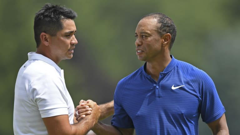 Buddies: Tiger Woods has great respect for Day's achievements.