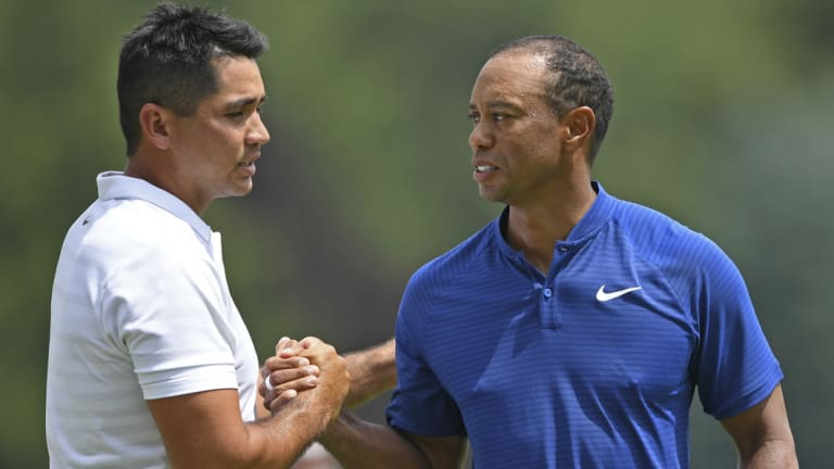 Emotional day: Woods and Day shake hands after the first round of the Bridgestone Invitational.