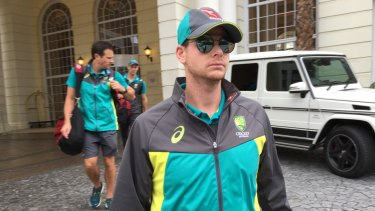 Facing up: Steve Smith leaves his Cape Town hotel as the ball-tampering scandal blew up in March.