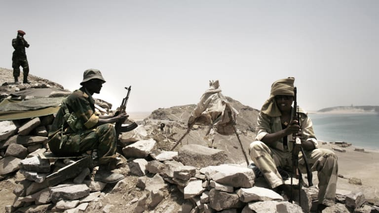 An Eritrean soldier, right, patrols the border opposite Djiboutian soldiers at the countries' disputed border near the Red Sea in 2008. Eritrea's military conscription is a major factor in youth fleeing the country.