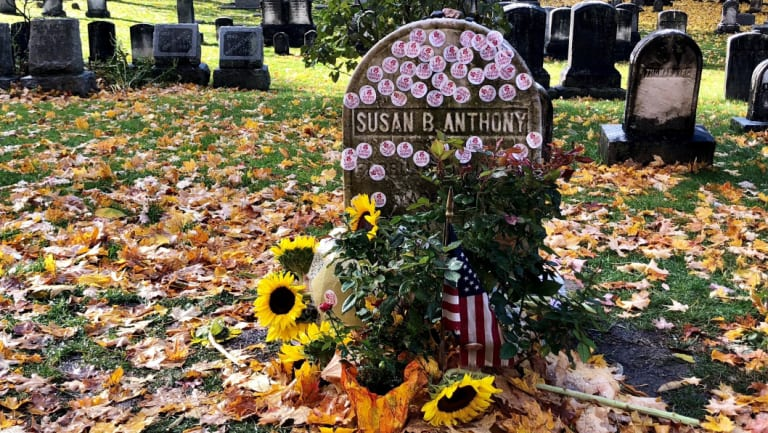 Susan Anthony's grave decorated with 'I Voted' stickers in Rochester, New York, after people voted in the midterms.