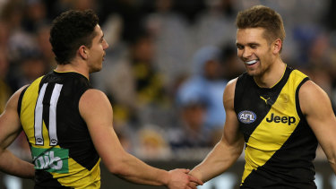 Roaring trade: Tigers Dan Butler and Jason Castagna celebrate a goal against the Cats.