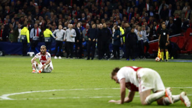 Down and out: Ajax's Hakim Ziyech and Ajax's Frenkie de Jong, right, in front of a stunned crowd after Tottenham scored their third goal.