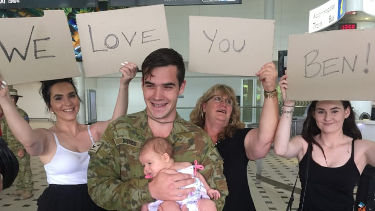 Jenna, Ruby, Janell and Emily were waiting for Private Benjamin Driver at Brisbane Airport on Thursday afternoon.