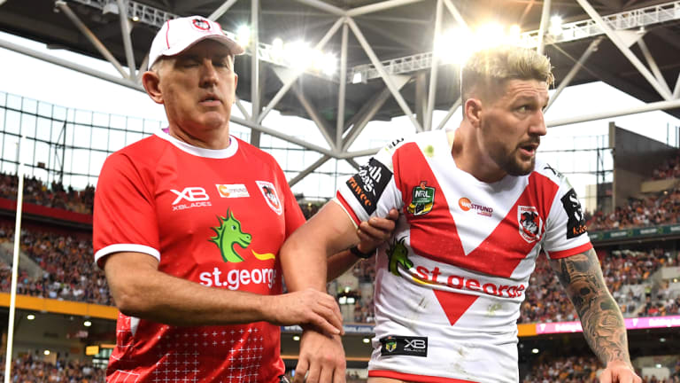 Major loss: Gareth Widdop is walked off the field after again dislocating his shoulder.