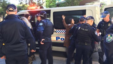 Police make their second round of arrests, directly opposite Brisbane Magistrates Court.