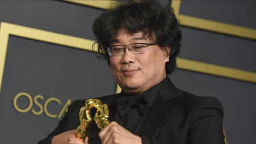 Bong Joon-Ho with the awards for best director and best international feature film for Parasite at the Oscars.