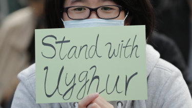 A Hong Kong protester shows support for Uighurs and their fight for human rights.