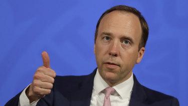 Britain's Health Secretary, Matt Hancock gives a thumbs up gesture during a virtual press conference.
