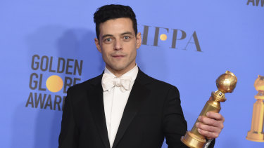 Rami Malek with the Golden Globe for best performance by an actor in a motion picture, drama.