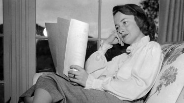 Olivia de Havilland reading a script in 1948.