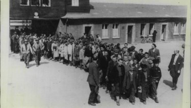 Prisoners at Buchenwald concentration camp, one of many camps across Nazi Germany, are pictured being freed in 1945.