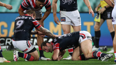 Boyd Cordner struggles to get up after hitting his head on the ground against the Knights.