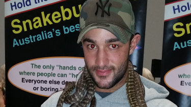 Matthew Gatt, 23, posing with snakes at the Melbourne Convention Centre in December.