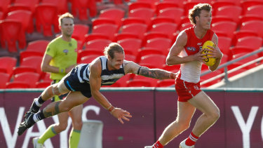 Full flight: Geelong's Tom Stewart launches into a tackle on Sydney's Nick Blakey.