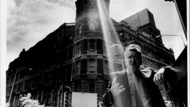 Ray of hope: Vince Higgins, secretary of the Federated Clerks Union, in front of the old Trades Hall building in Haymarket, which has been reprieved from demolition, 1987.