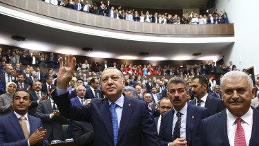 Turkish President Recep Tayyip Erdogan, centre, arrives to deliver a speech last week.