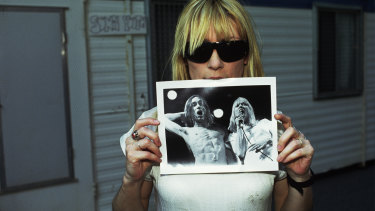 """Kim Gordon holds a photo of herself with Iggy Pop: """"I like a certain amount of tension in music."""""""