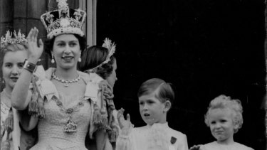 Queen Elizabeth with Prince Charles and Princess Anne on the balcony of Buckingham Palace after the coronation.