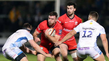 Saracens, in red, escaped an early exit from the European competition.