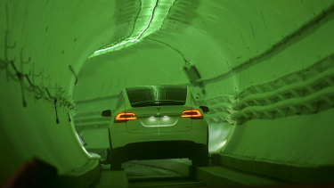 Elon Musk unveiled his underground transport tunnel for reporters and guests.