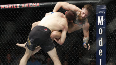 Khabib goes in for the takedown against Conor McGregor.