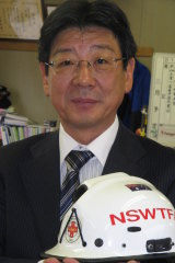Minamisanriku mayor Jin Sato holds a treasured reminder of the immediate help Australia gave his town after the tsunami hit in 2011.