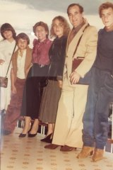 A teenage MauriceTerzini  (at right), wearing suede boots,  with his family in Italy in 1978.