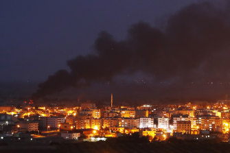 Smoke billows from fires in Ras al-Ayn, Syria, caused by bombardment from Turkish forces before a ceasefire deal was struck.