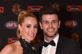Brooke Cotchin, left, with her husband Trent Cotchin.