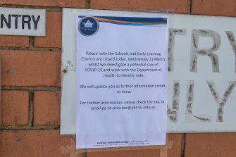 A notice posted up outside the school.