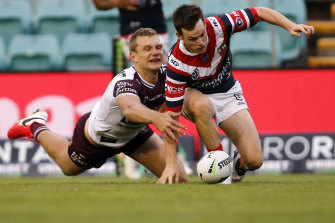 Tom Trbojevic saves a certain try by knocking the ball from Luke Keary's grasp over the try line on Saturday.