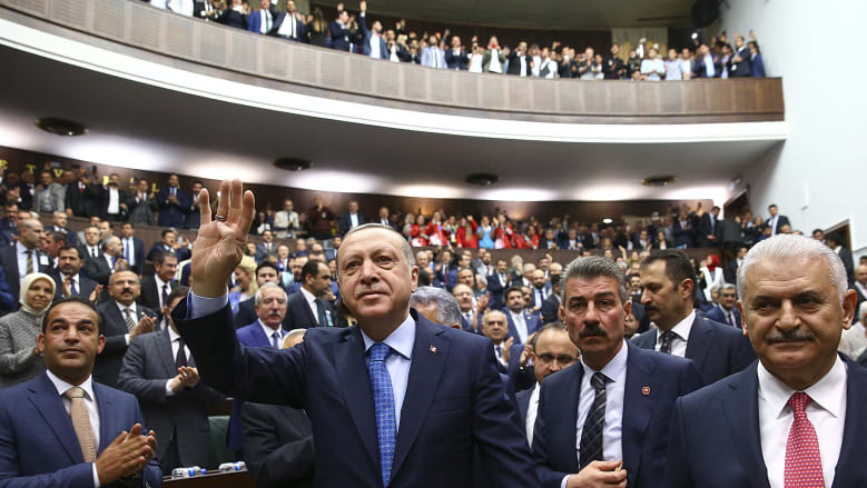 Turkish President Recep Tayyip Erdogan, centre, arrives to deliver a speech last week.