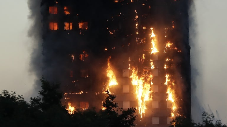 Smoke and flames rise from the Grenfell Tower building in June 2017.