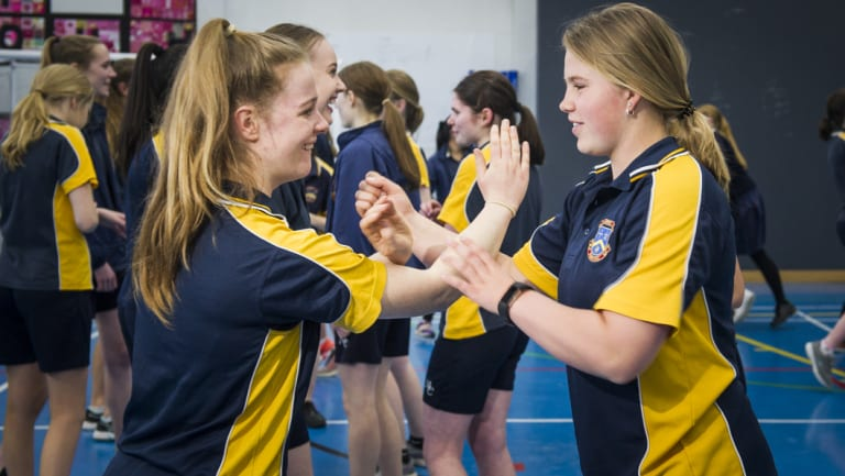 Merici College year 10 students Hayley Browne and Alex Rushton, both 16, who take part in self defence training.