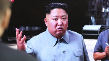 North Korea's Kim Jong-un, seen here on a TV screen in Seoul, has again fired projectiles into the sea.